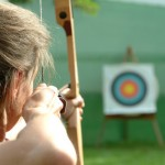 Woman Aiming at Archery Target