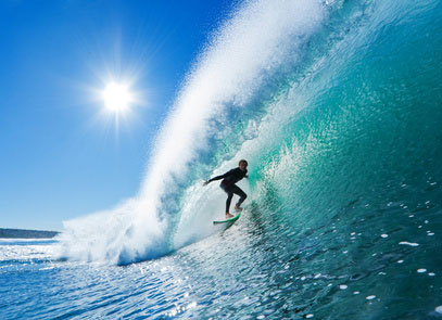 Surfer on a Blue Ocean Wave