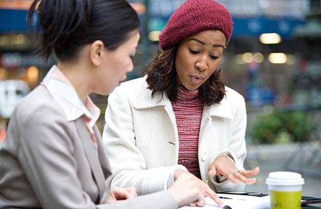 Two Millennial Women Discussing Work