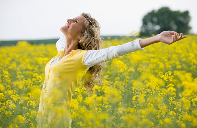 Joyful Optimistic Woman in Yellow Field