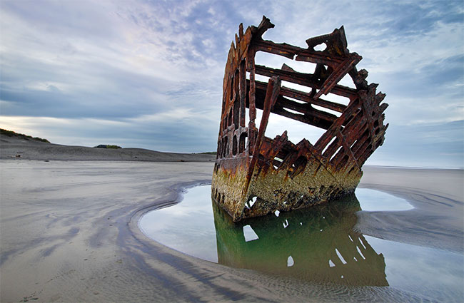 Rusty Shipwreck on Beach