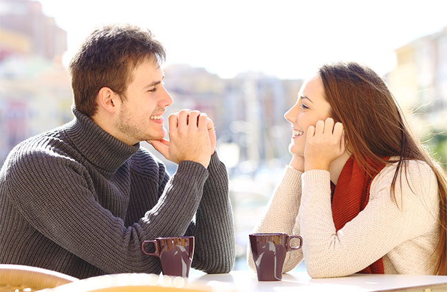 Couple Gazing into Each Other's Eyes over Coffee