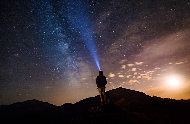 Shining a Headlamp into Night Sky