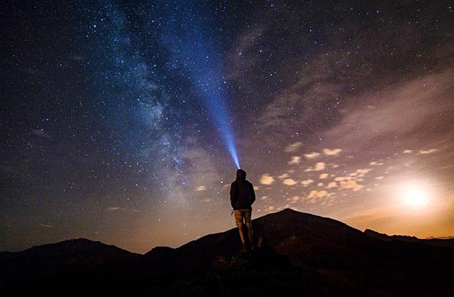 Shining a Headlamp into Night Sky