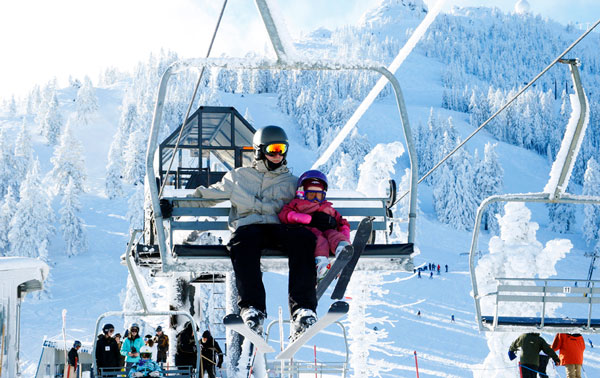 Parent and Child on Ski Lift at Mt. Ashland
