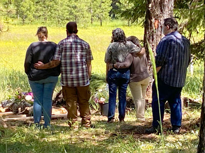 Family Grieving at Burial in The Forest